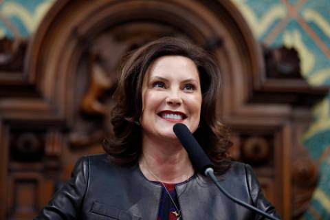 Michigan Gov. Gretchen Whitmer delivers her State of the State address to a joint session of th ...