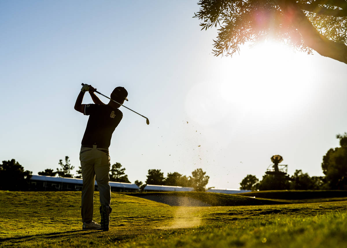 Kevin Na hits onto the green at hole 18 during the final round of Shriners Hospitals for Childr ...