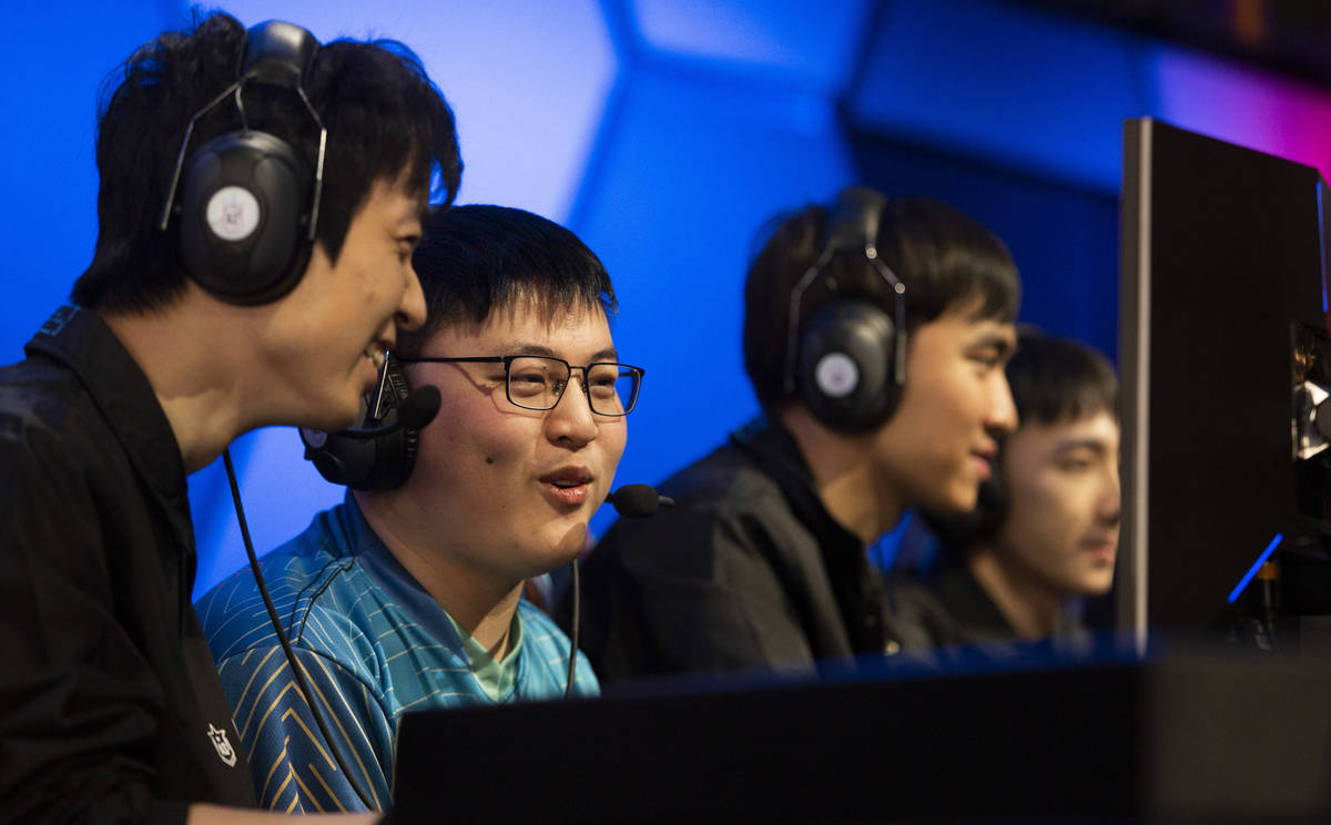 Xiao Wang, left, and Jian Zihao, second from left, known together as UziGod, play tandem League ...
