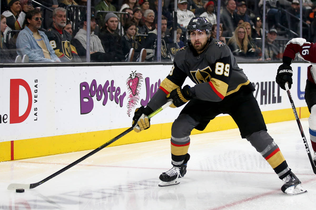Vegas Golden Knights right wing Alex Tuch (89) moves the puck in front of Colorado Avalanche de ...