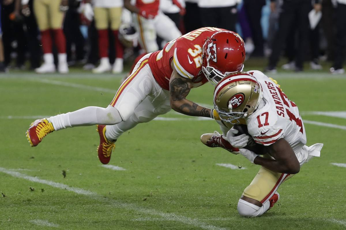 Kansas City Chiefs' Tyrann Mathieu (32) tackles San Francisco 49ers' Emmanuel Sanders (17) duri ...