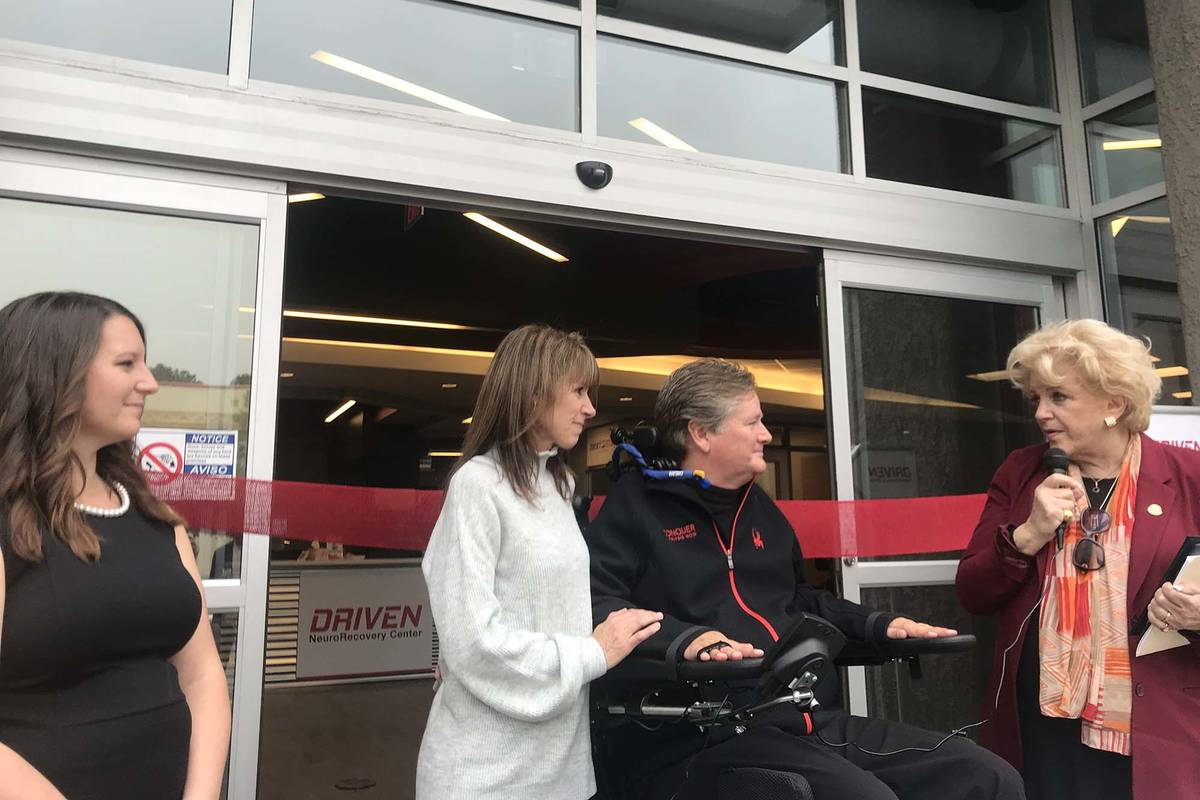 Sam Schmidt, founder of DRIVEN NeuroRecovery Center, poses with his wife, Sheila, and the cente ...