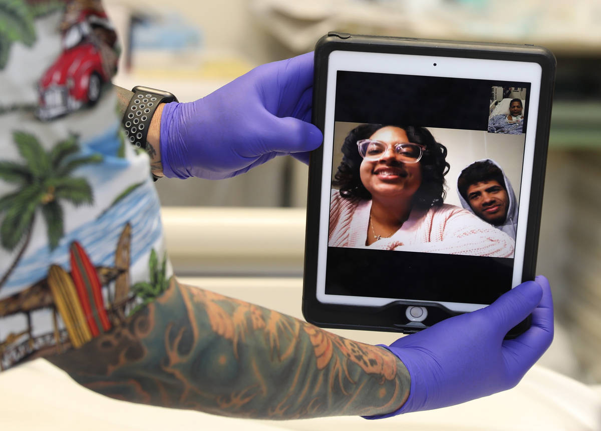 Former Marine Pvt. Ronald Pipkins, 55, Facetimes with his kids, Jaela and Ronald, as he recover ...