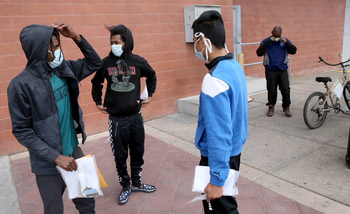 Terry Whitehead, 21, from left, Tai-Ree Williams, 22, John Ricaza, 28, and Carl Parker, 52, are ...