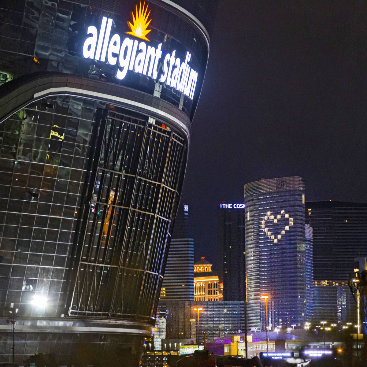 The lights for the exterior signage of Allegiant Stadium are lit as construction continues in L ...