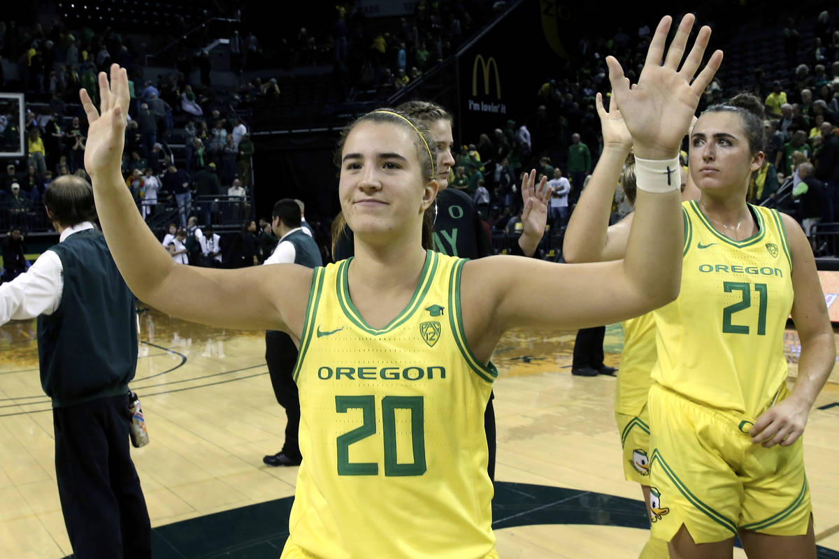 FILE - In this Nov. 16, 2019, file photo, Oregon's Sabrina Ionescu acknowledges the crowd with ...