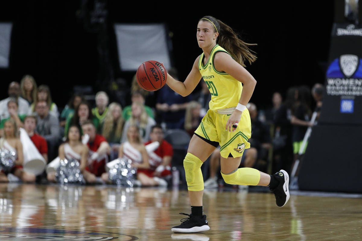FILE - In this March 6, 2020, file photo, Oregon's Sabrina Ionescu (20) plays against Utah in a ...