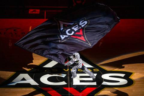 Buckets waves the flag as the Las Vegas Aces ready to face the Washington Mystics during the fi ...
