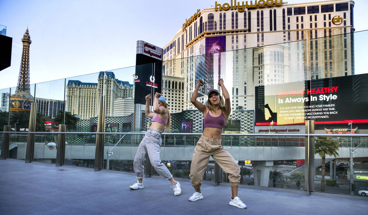 Carolyn Oliver, left, and Lisa Love practice a dance routine on a pedestrian bridge near the Co ...