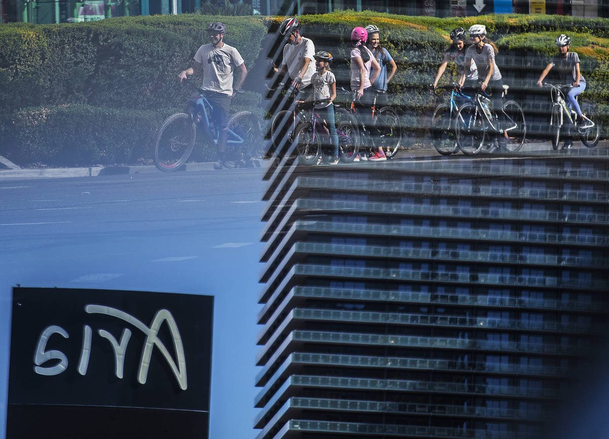 A large group of bicyclists wait at a light across from Aria on the Strip on Thursday, April 1 ...