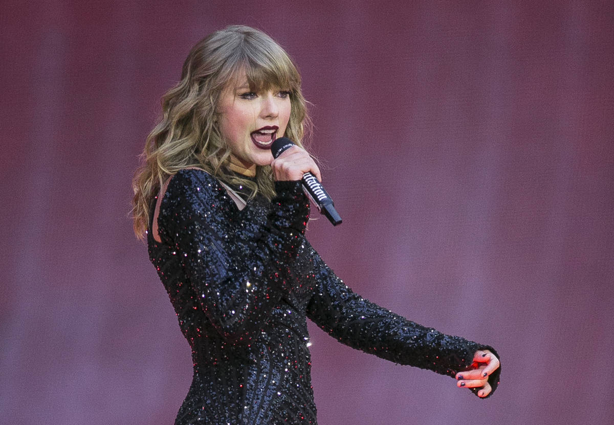 In this June 22, 2018, file photo, singer Taylor Swift performs on stage in concert at Wembley ...