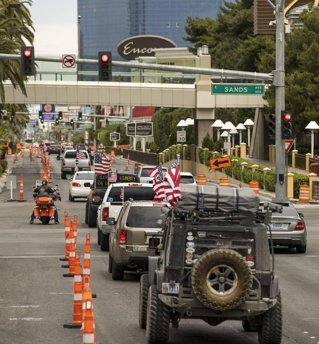 A caravan drives up the Las Vegas Strip to the Reopen Nevada protest against Gov. Sisolak to op ...