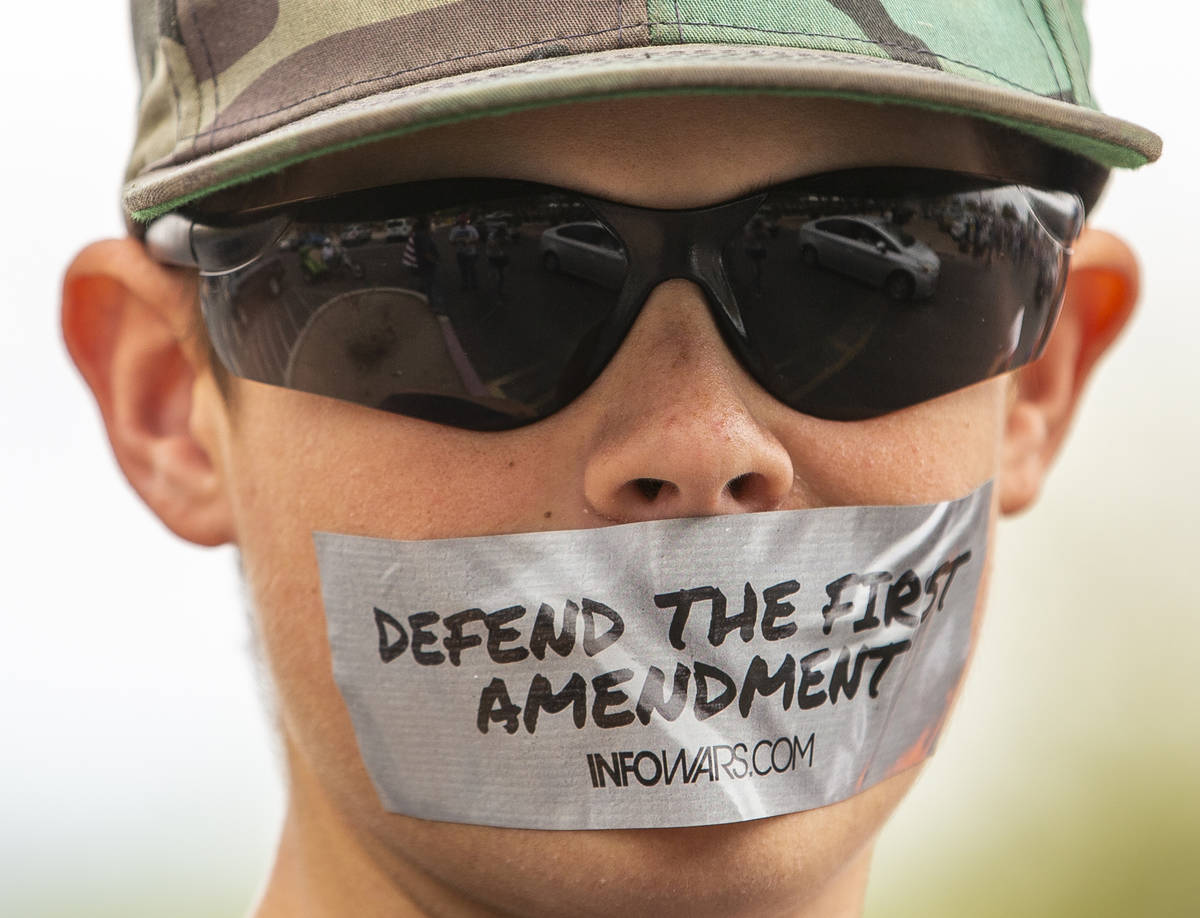 A silent protester makes his point at the Grant Sawyer State Office Building organized by Reope ...