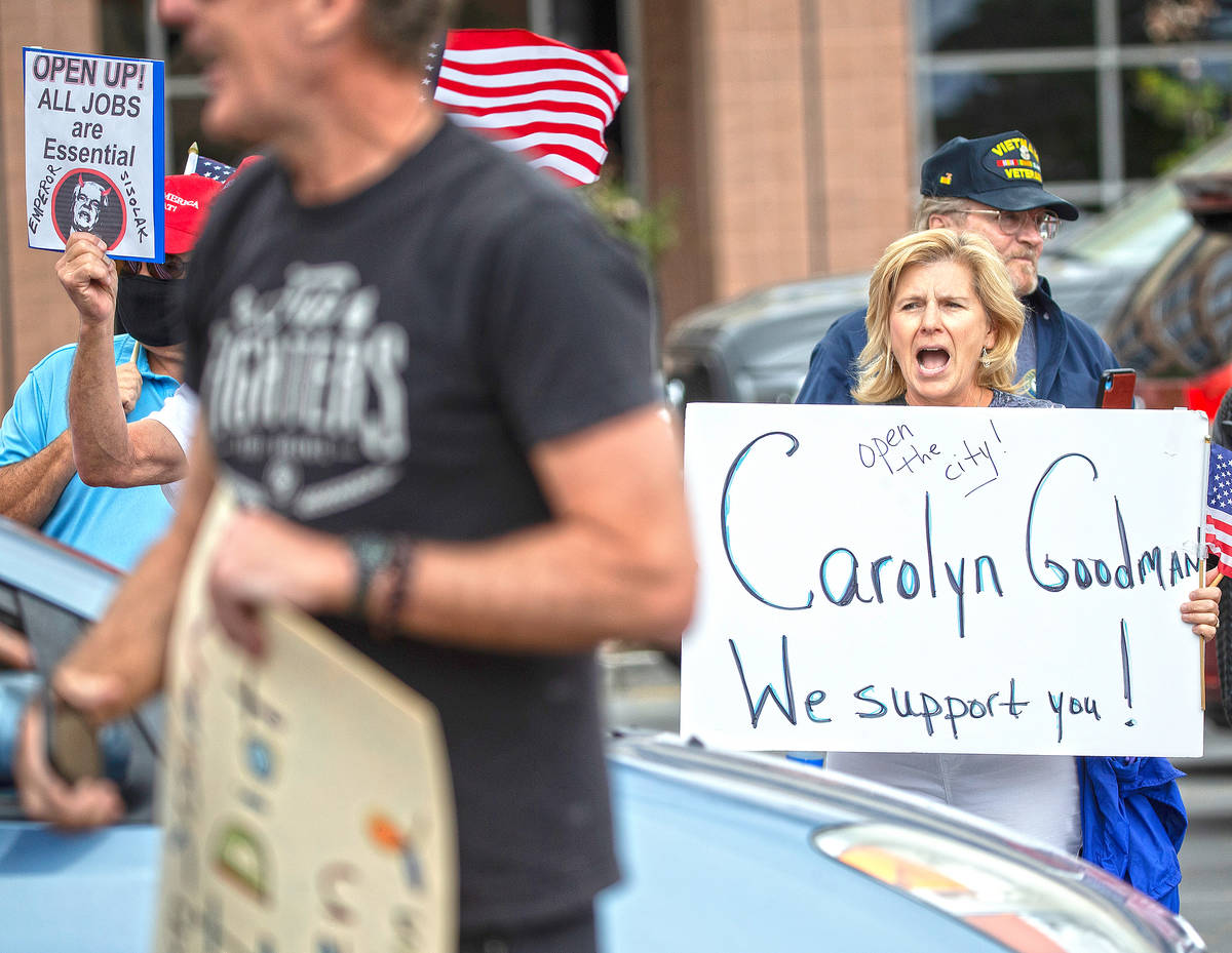 Sue Thiel, right, takes part in a protest outside the Grant Sawyer State Office Building organi ...