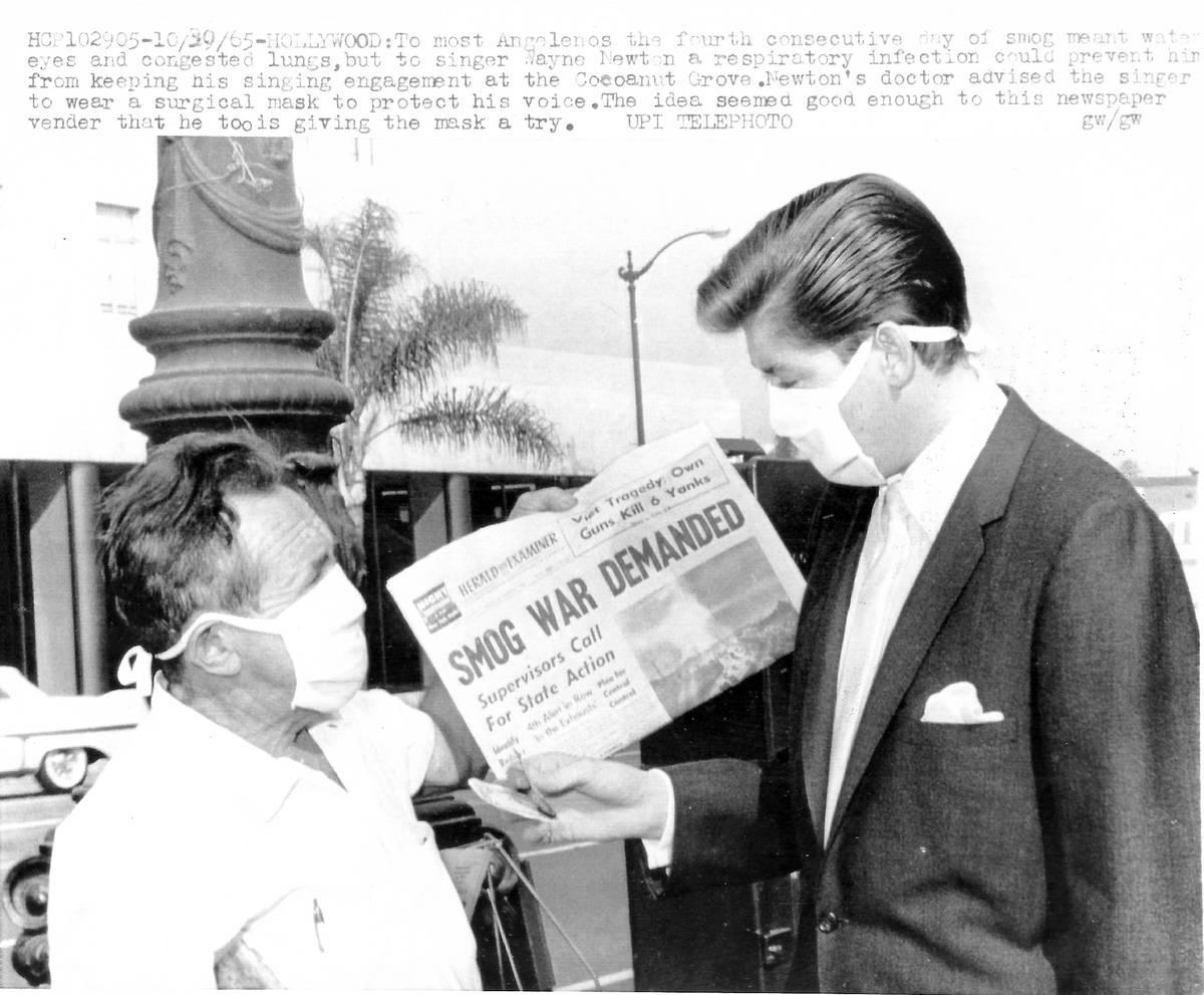Wayne Newton is shown wearing a medical mask in this United Press International photo in Los An ...