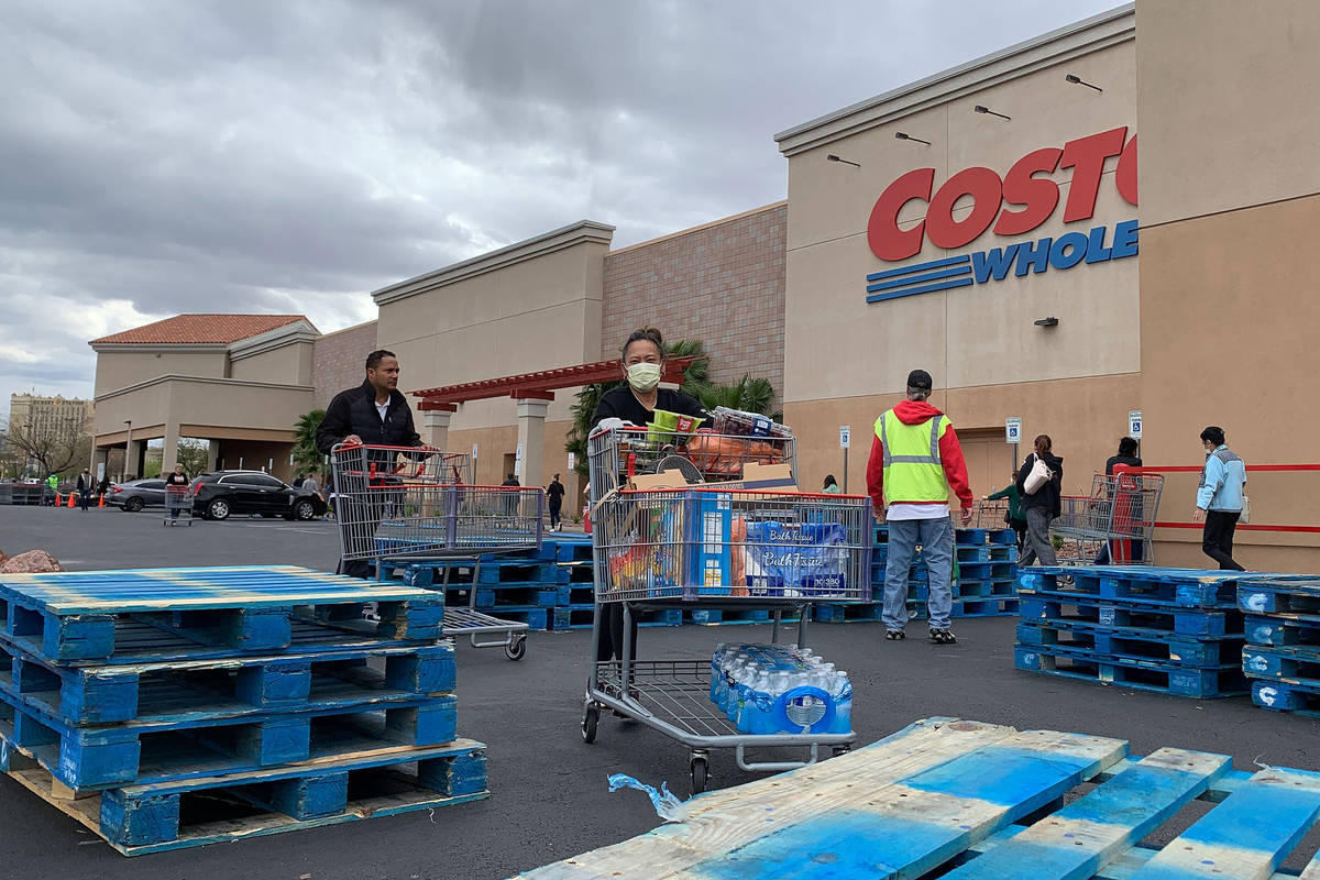 Shoppers push the carts in front of Costco at 791 Marks St, in Henderson, Sunday, March 29, 202 ...