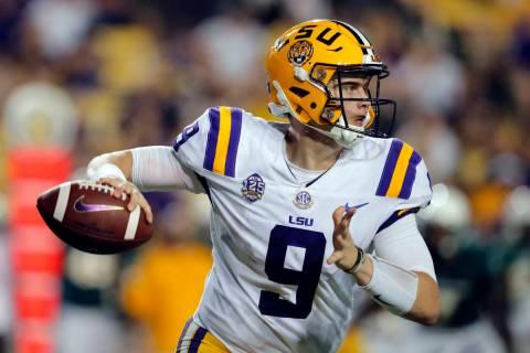 FILE - In this Saturday, Sept. 8, 2018, file photo, LSU quarterback Joe Burrow (9) scrambles as ...