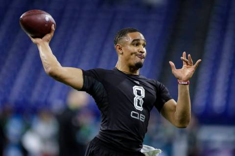 FILE - In this Feb. 27, 2020, file photo, Oklahoma quarterback Jalen Hurts runs a drill at the ...