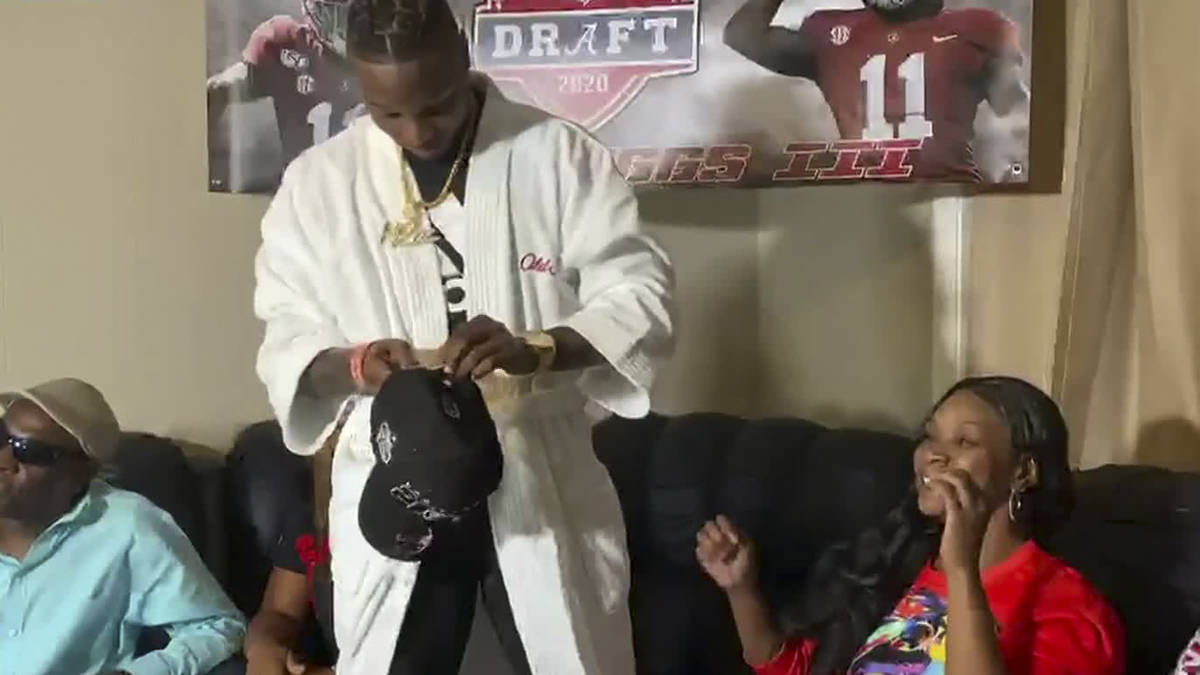 In this still image from video provided by the NFL, Henry Ruggs III gets ready to put on a Las ...