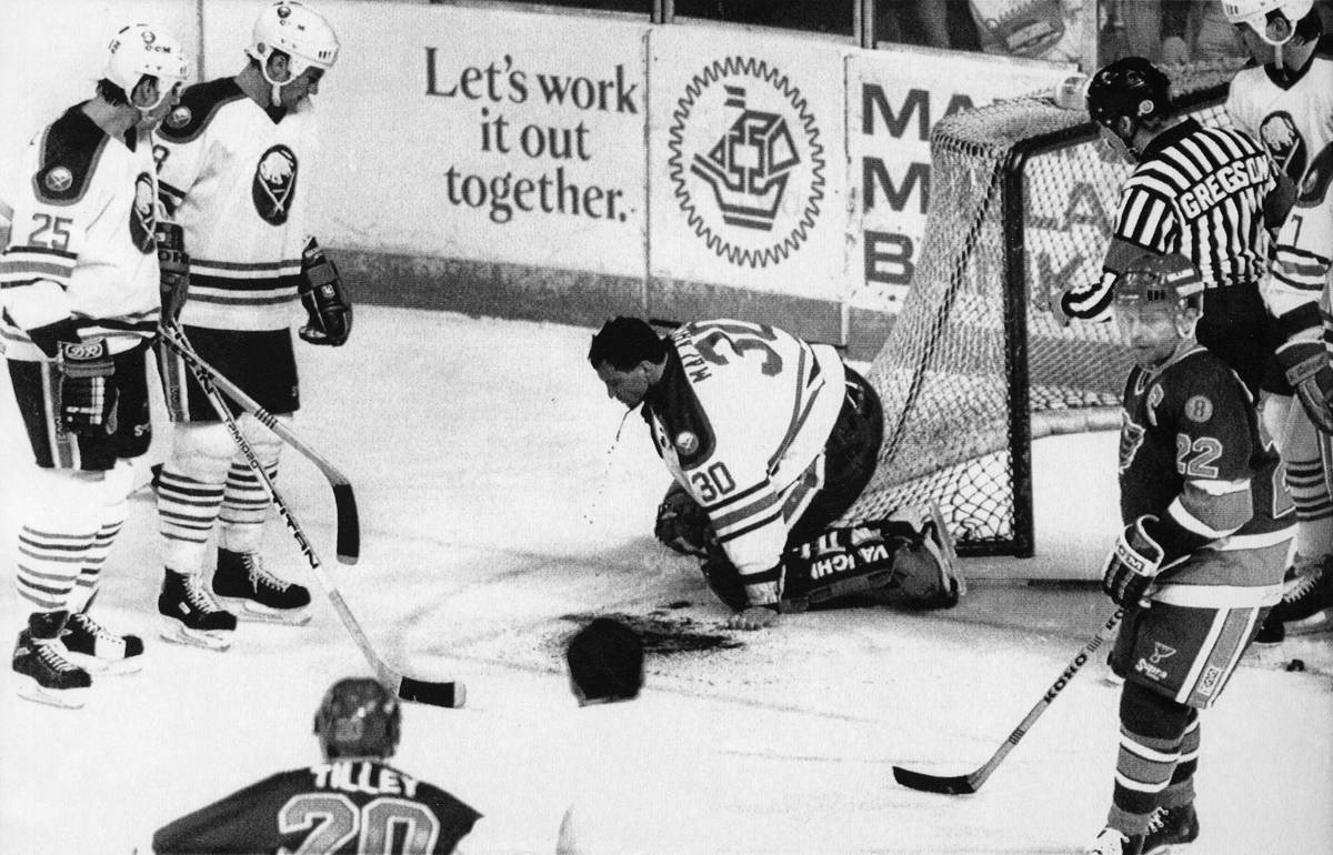 EDS NOTE - GRAPHIC CONTENT Buffalo Sabres goalie Clint Malarchuk clutches his throat after suff ...