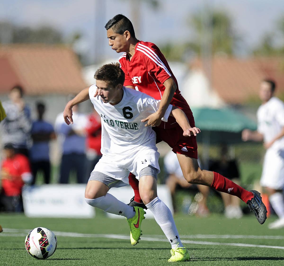 Valley midfielder John Cerda challenges Palo Verde midfielder Connor Ryan (6) during the Divisi ...