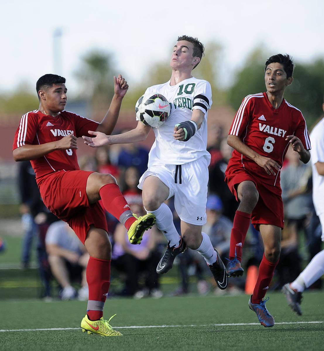 Palo Verde striker Nolan Sherwood (10) cradles a goal kick in front of Valley defender Abraham ...