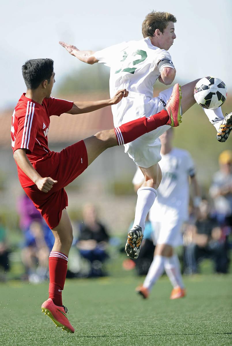 Palo Verde defender Griffin Mallas (12) challenges Valley midfielder Alejandro Parra, left, dur ...
