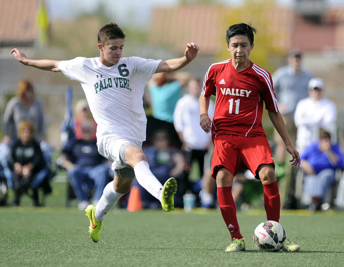 Palo Verde midfielder Connor Ryan (6) tries to block a pass by Valley forward Marco Gonzales (1 ...