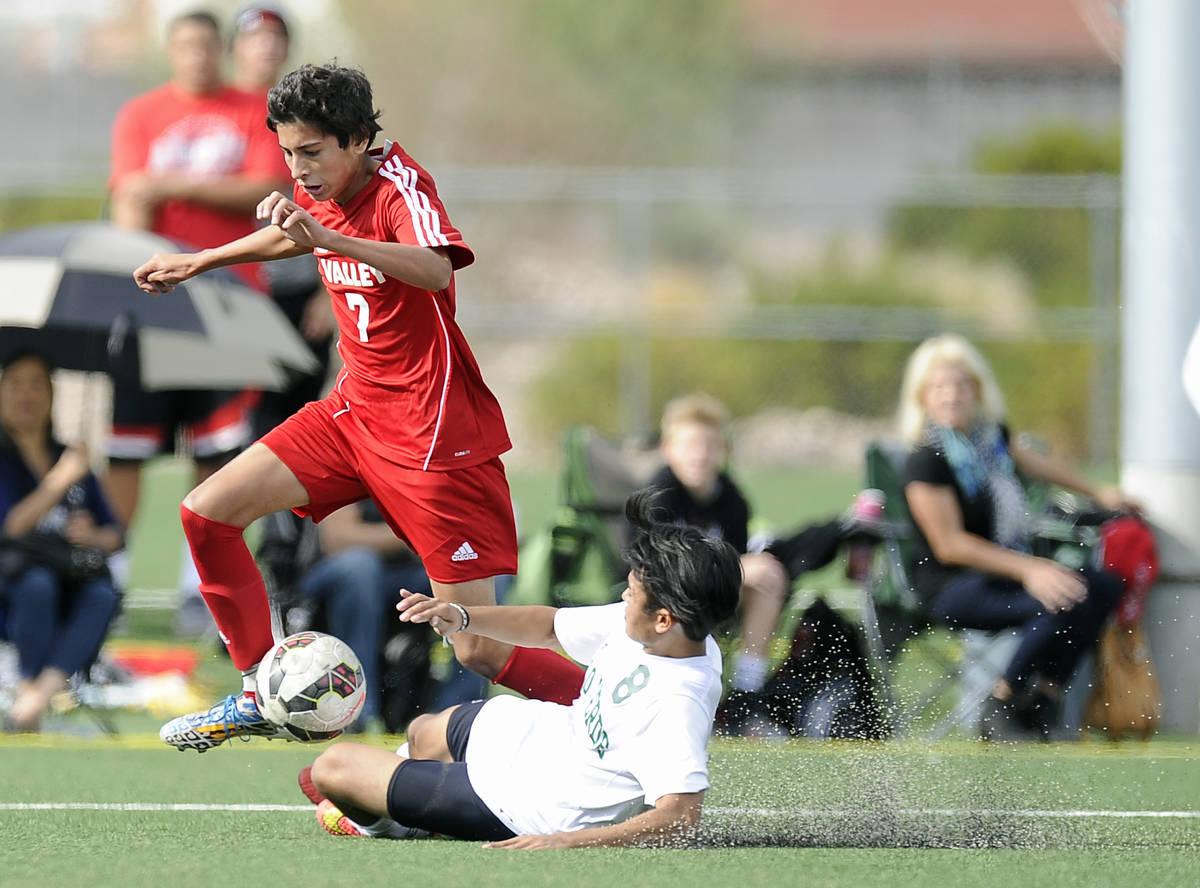Palo Verde defender Ben DeLeon (8) slide tackles Valley midfielder Sebastian Salcedo (7) during ...