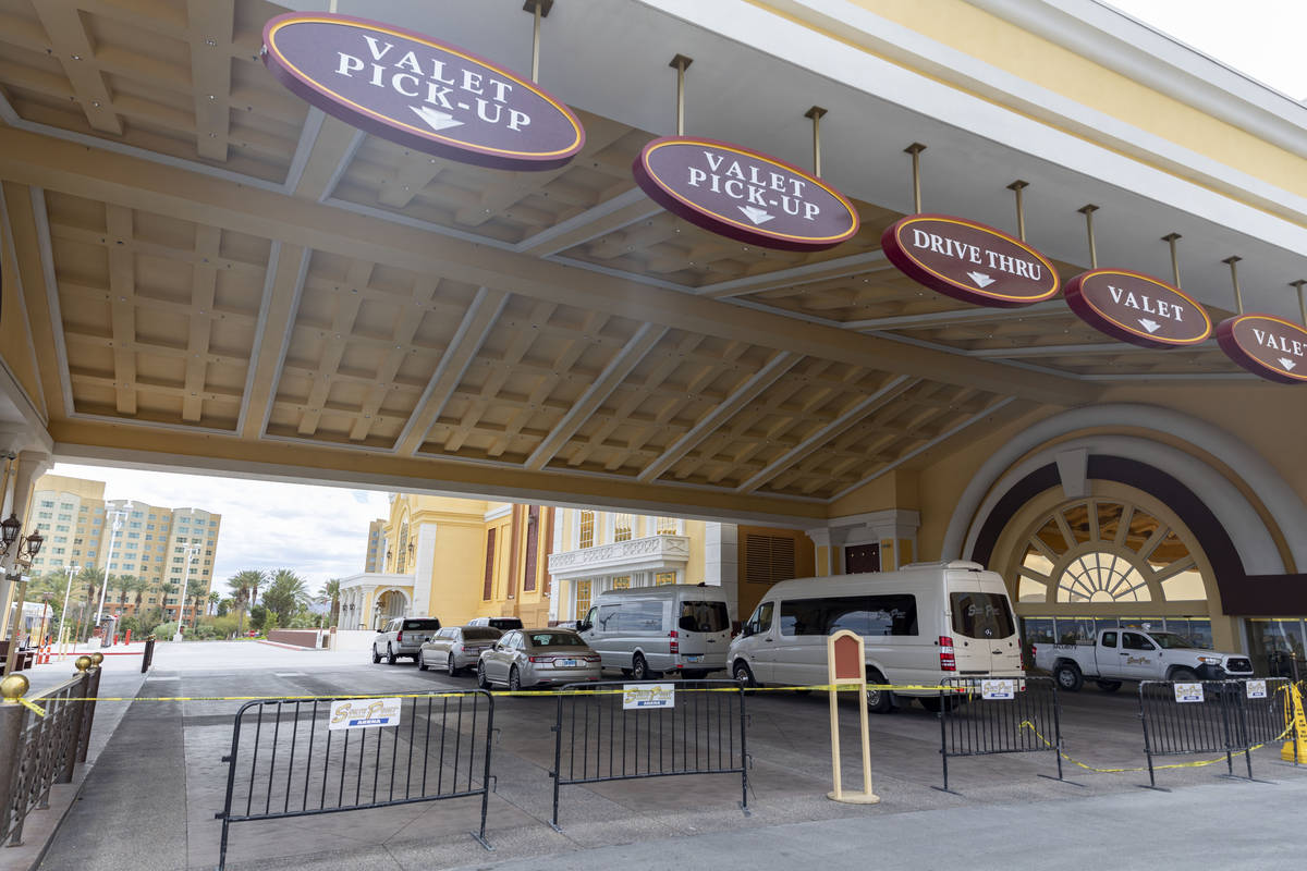 Caution tape and barriers block the valet and drive thru entrance of South Point while temporar ...