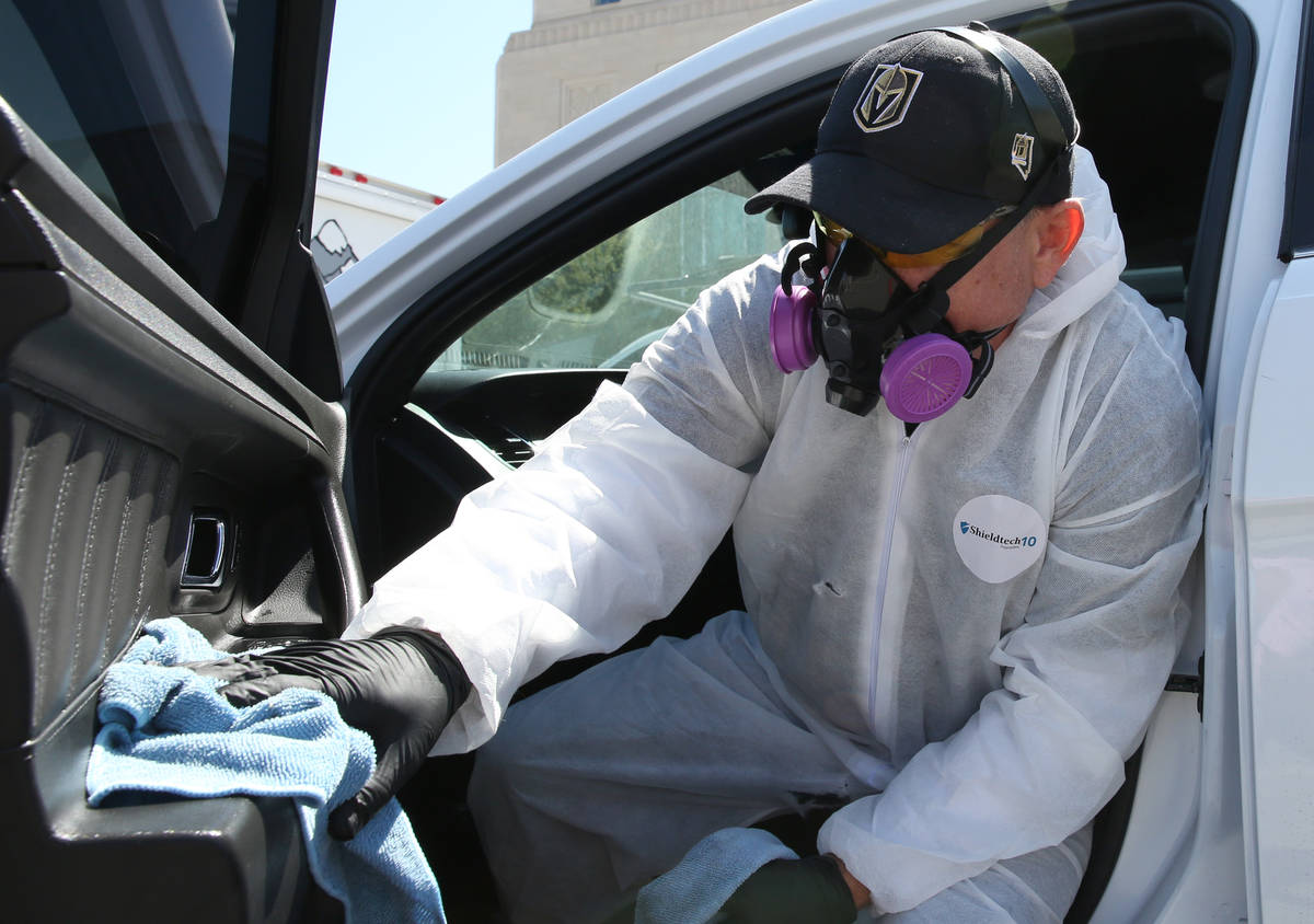 Adam Gunn of Immaculate Restoration disinfects a U.S. Marshall vehicle on Monday, April 20, 202 ...