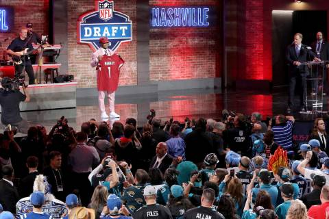 Oklahoma quarterback Kyler Murray shows off his new jersey after the Arizona Cardinals selected ...