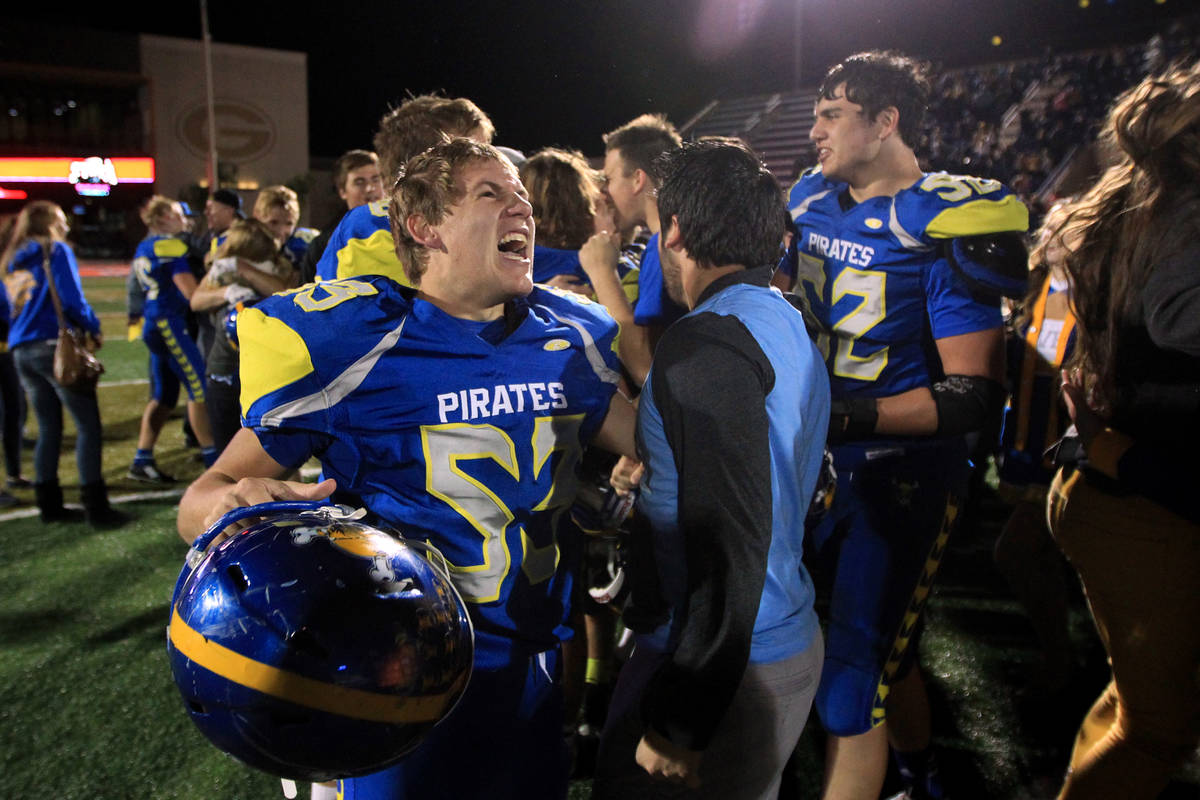 Moapa Valley players celebrate their 42-36 overtime win over Desert Pines in the Division I-A s ...