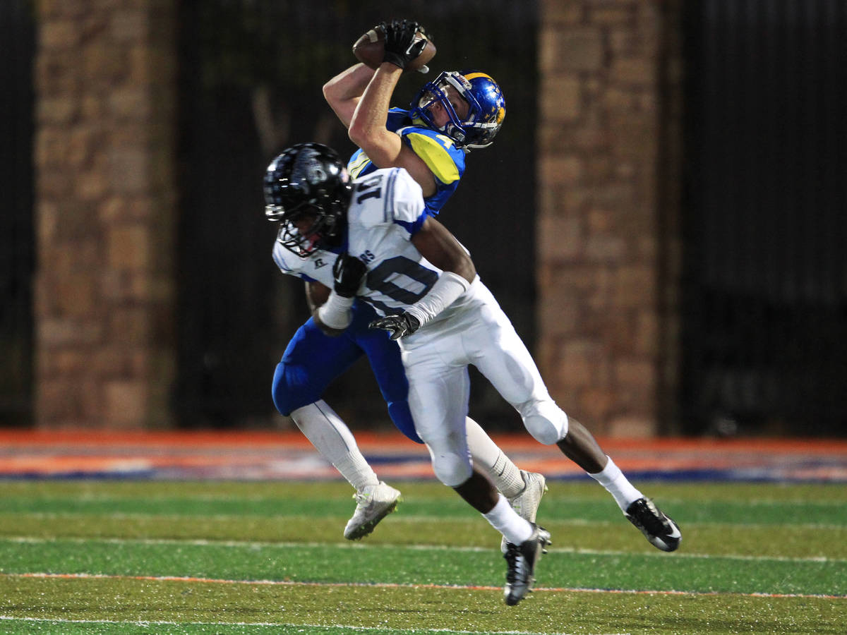 After beating Desert Pines safety Jon McCoy, Moapa Valley's Kaleb Bodily pulls in a fourth-down ...
