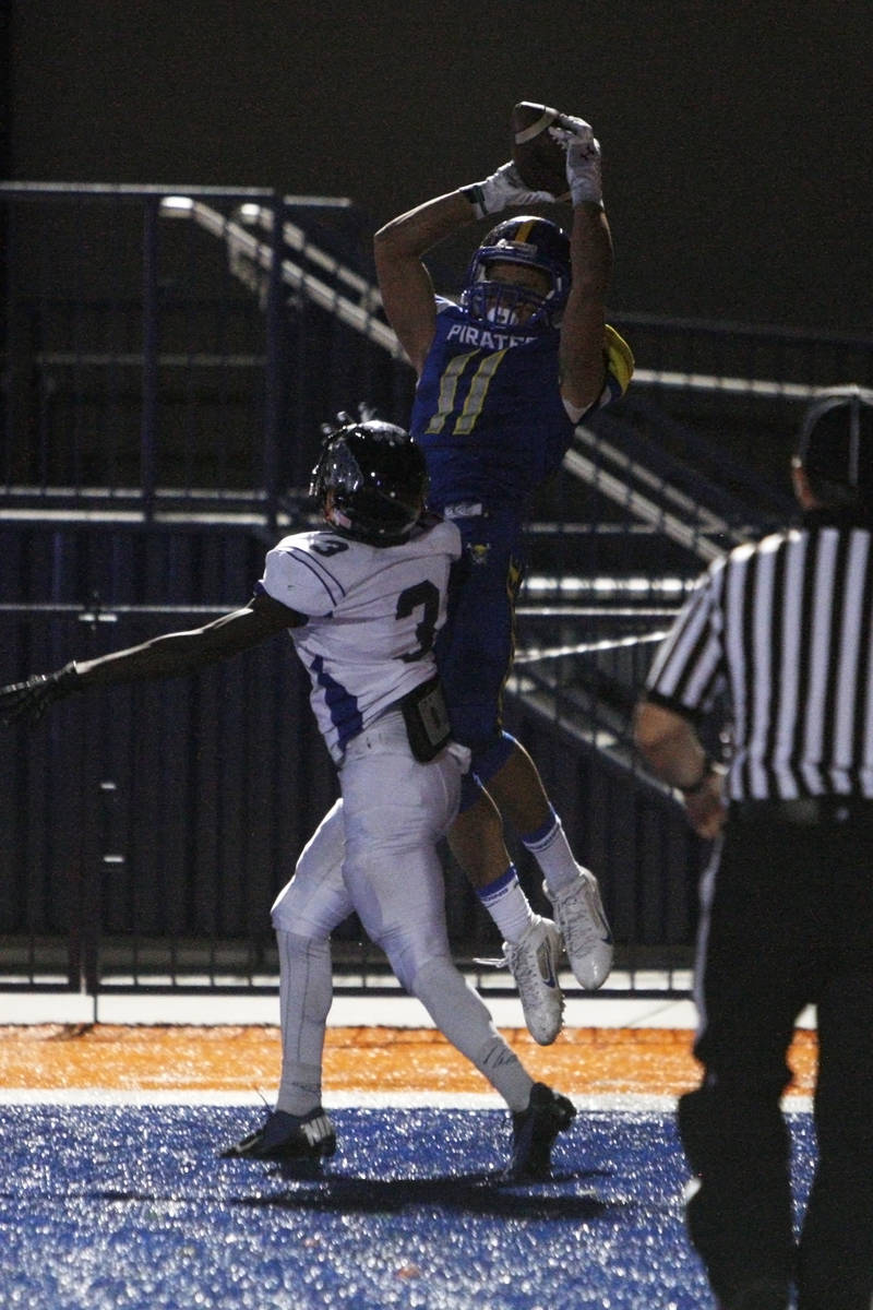 Moapa Valley wide receiver R.J. Hubert pulls in the game winning touchdown while being covered ...