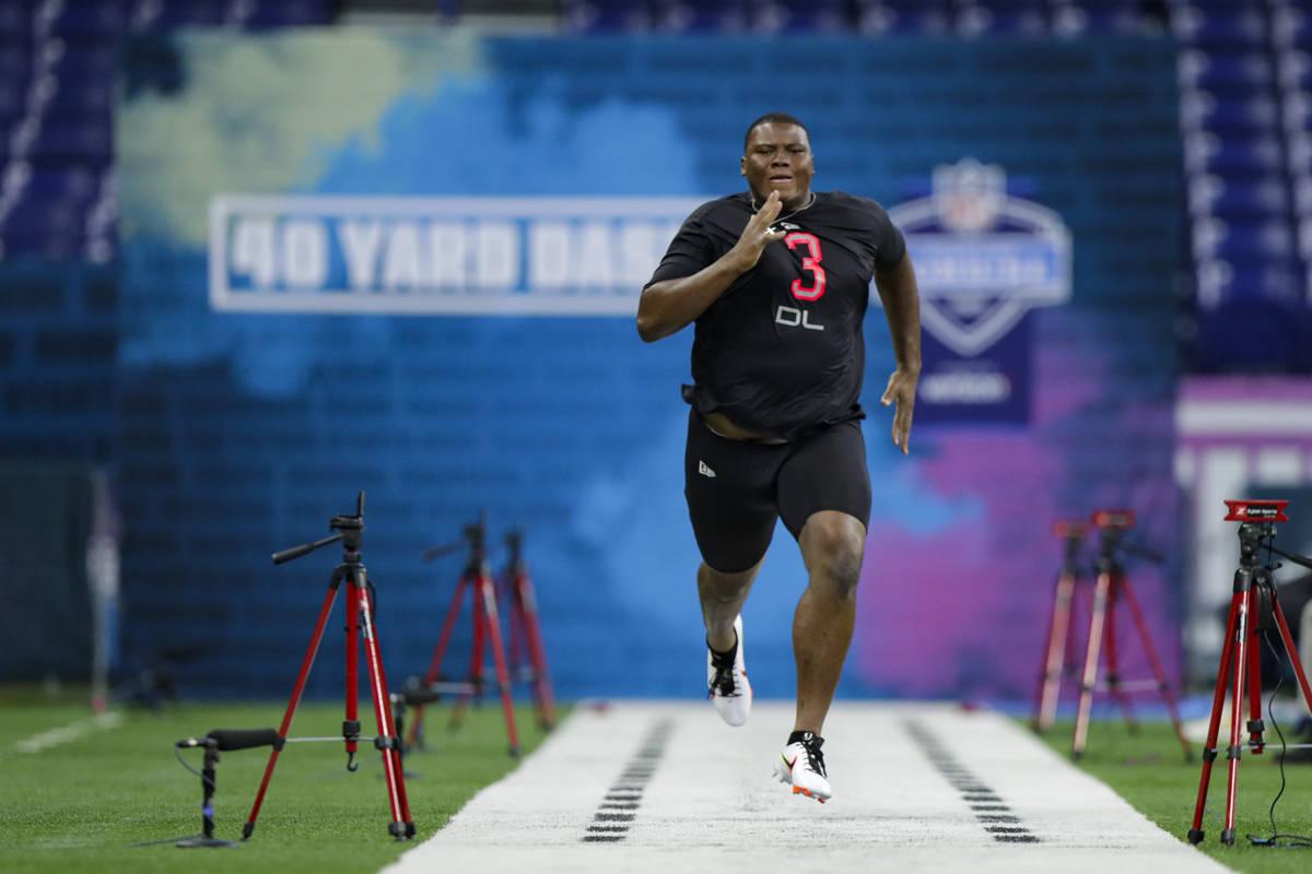 Auburn defensive lineman Derrick Brown runs the 40-yard dash at the NFL football scouting combi ...
