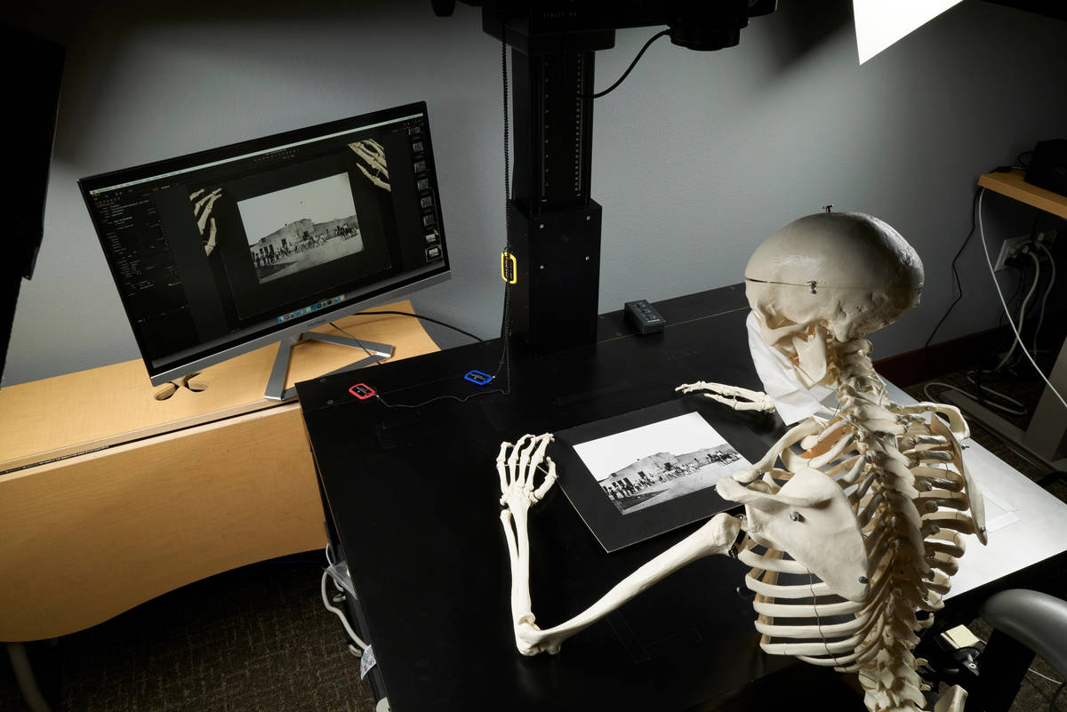 Scanning old family photos in Digital Collections. (Aaron Mayes/UNLV Special Collections)