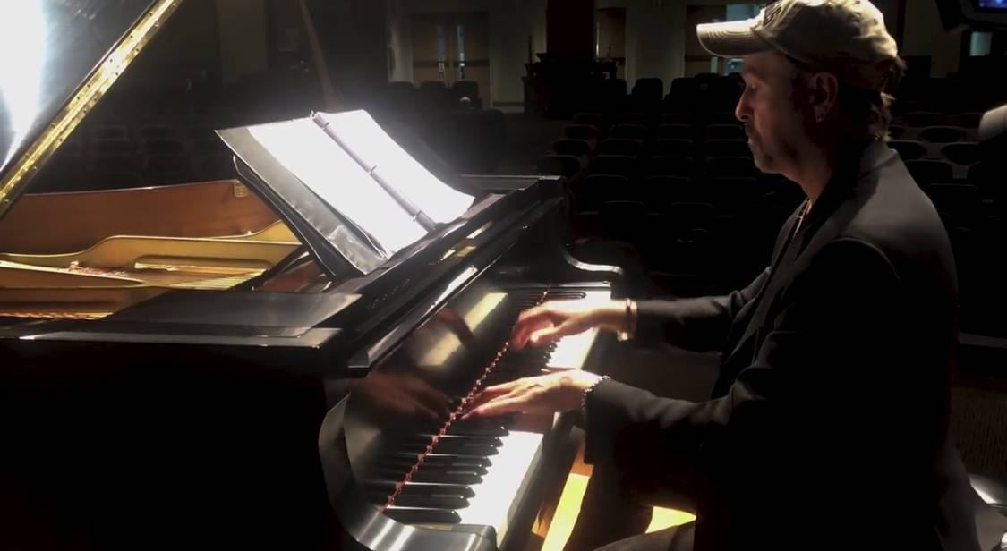 """Pianist Phil Fortenberry is shown in the new """"Needing Each Other"""" video, written by Keith Thomp ..."""