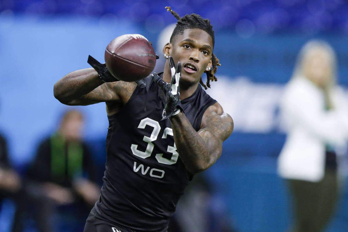 Oklahoma wide receiver Ceedee Lamb runs a drill at the NFL football scouting combine in Indiana ...
