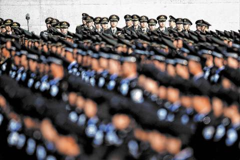 Members of the People's Liberation Army (PLA) attend a memorial ceremony at the Nanjing Massacr ...