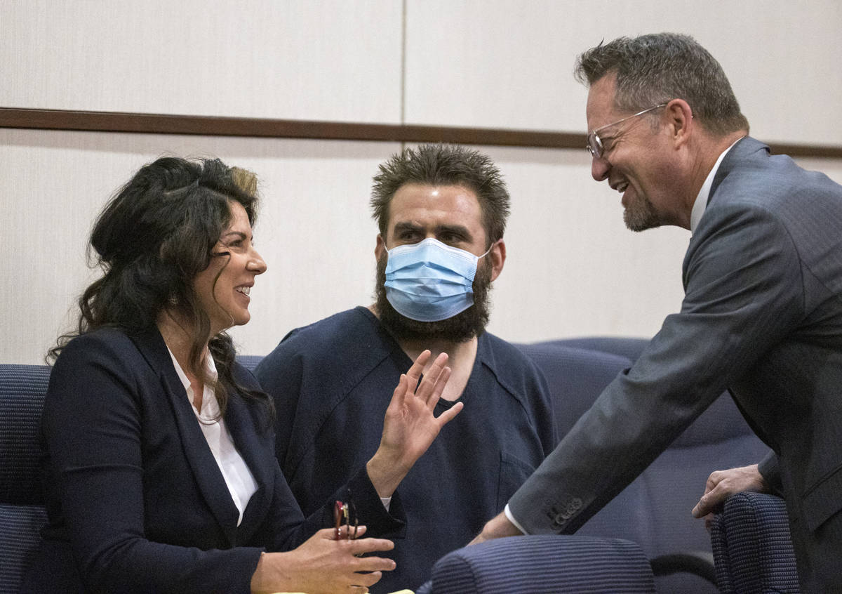 Joshua Nichols, center, confers with his lawyers Julie Raye, left, and Robert Draskovich during ...