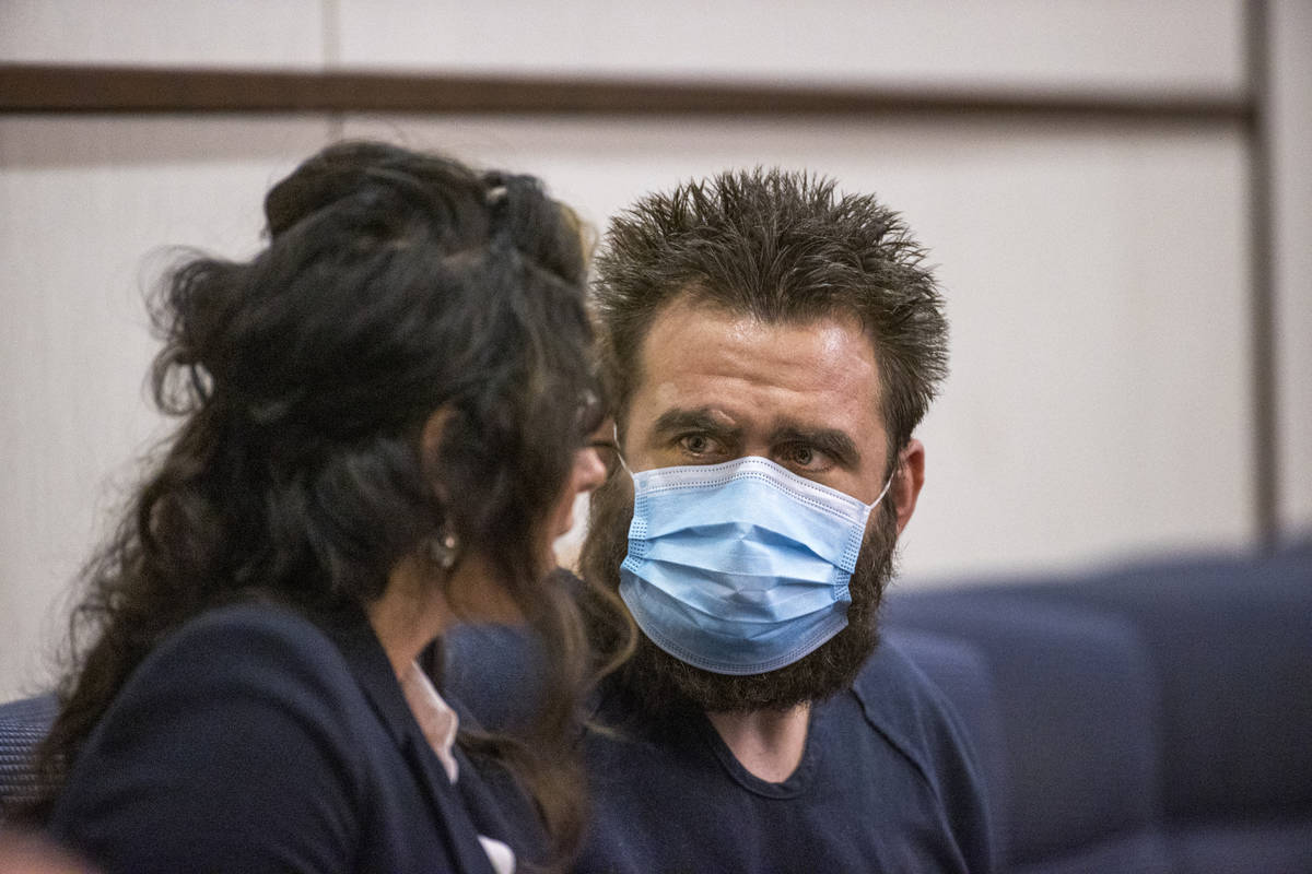 Joshua Nichols, right, confers with his lawyer Julie Raye during his hearing at Henderson Justi ...