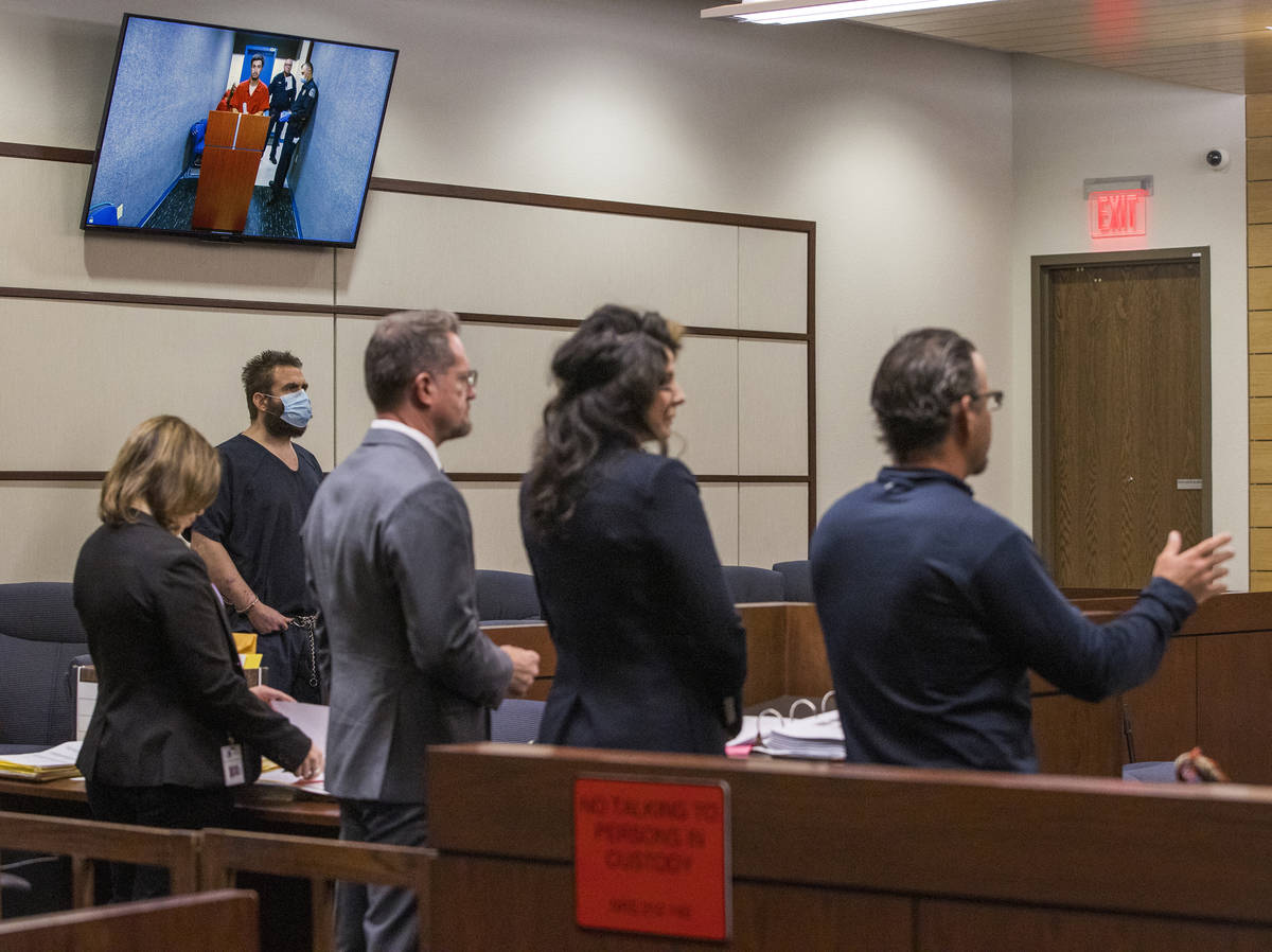 Joshua Nichols, left, listens to lawyers during a hearing with co-defendant George Moya on vide ...