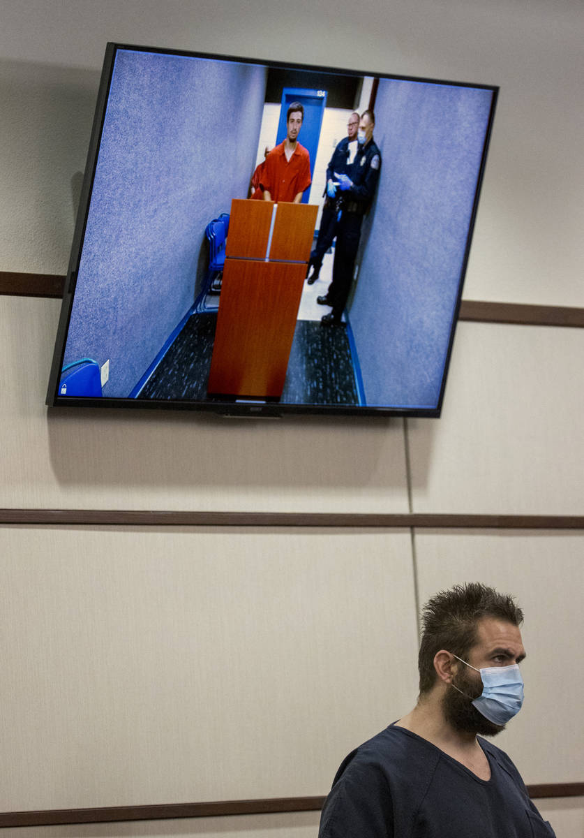 Joshua Nichols, below, appears with co-defendant George Moya on video feed, above, during their ...