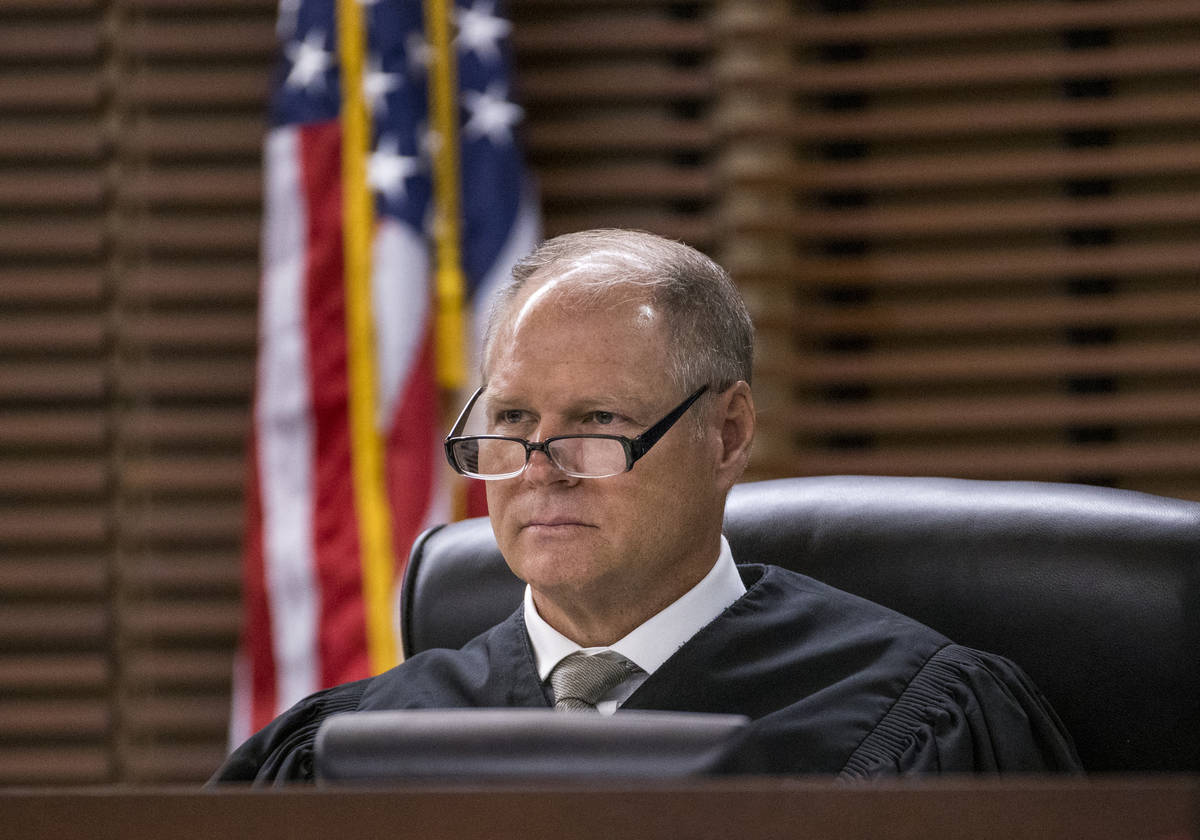 Justice of the Peace Stephen George presides over a court hearing for Joshua Nichols and George ...