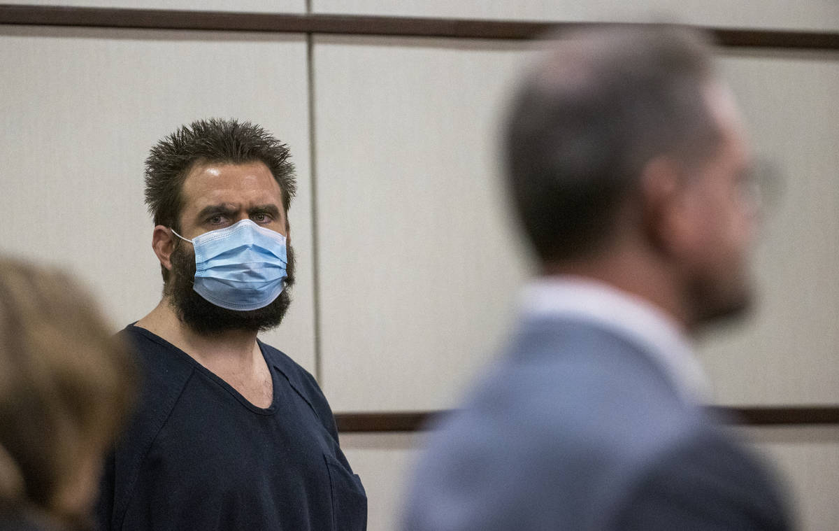 Joshua Nichols, center, listens to his lawyer Robert Draskovich, right, during his hearing at H ...