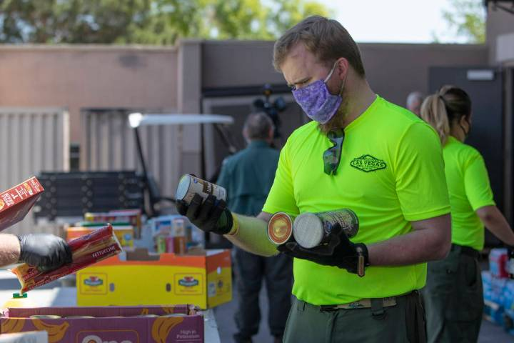 Bryce McCandless, a staff member at the Las Vegas Council of the Boy Scouts, sorts through dona ...