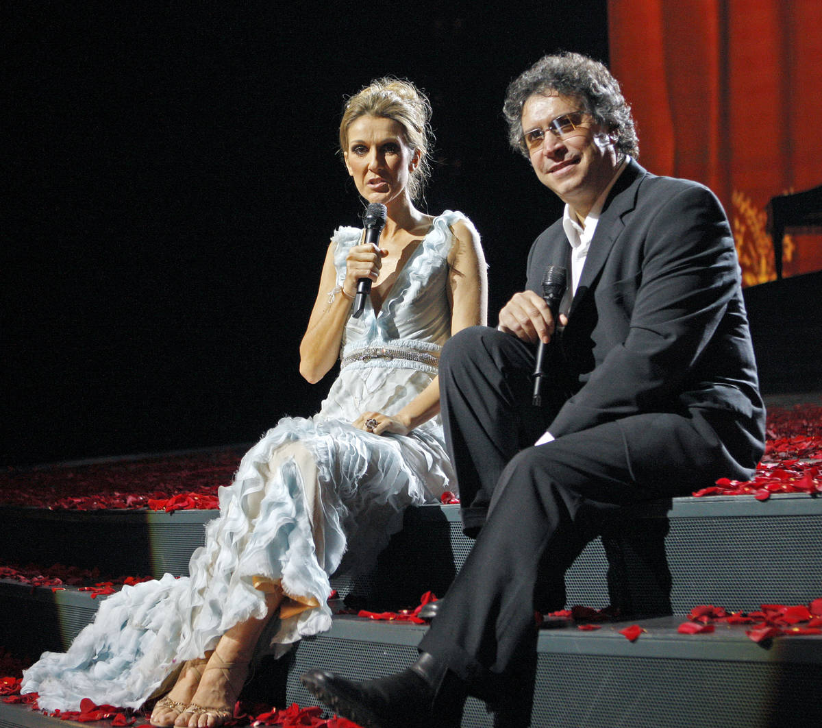 Celine Dion answers questions during a press conference as Franco Dragone looks on following th ...