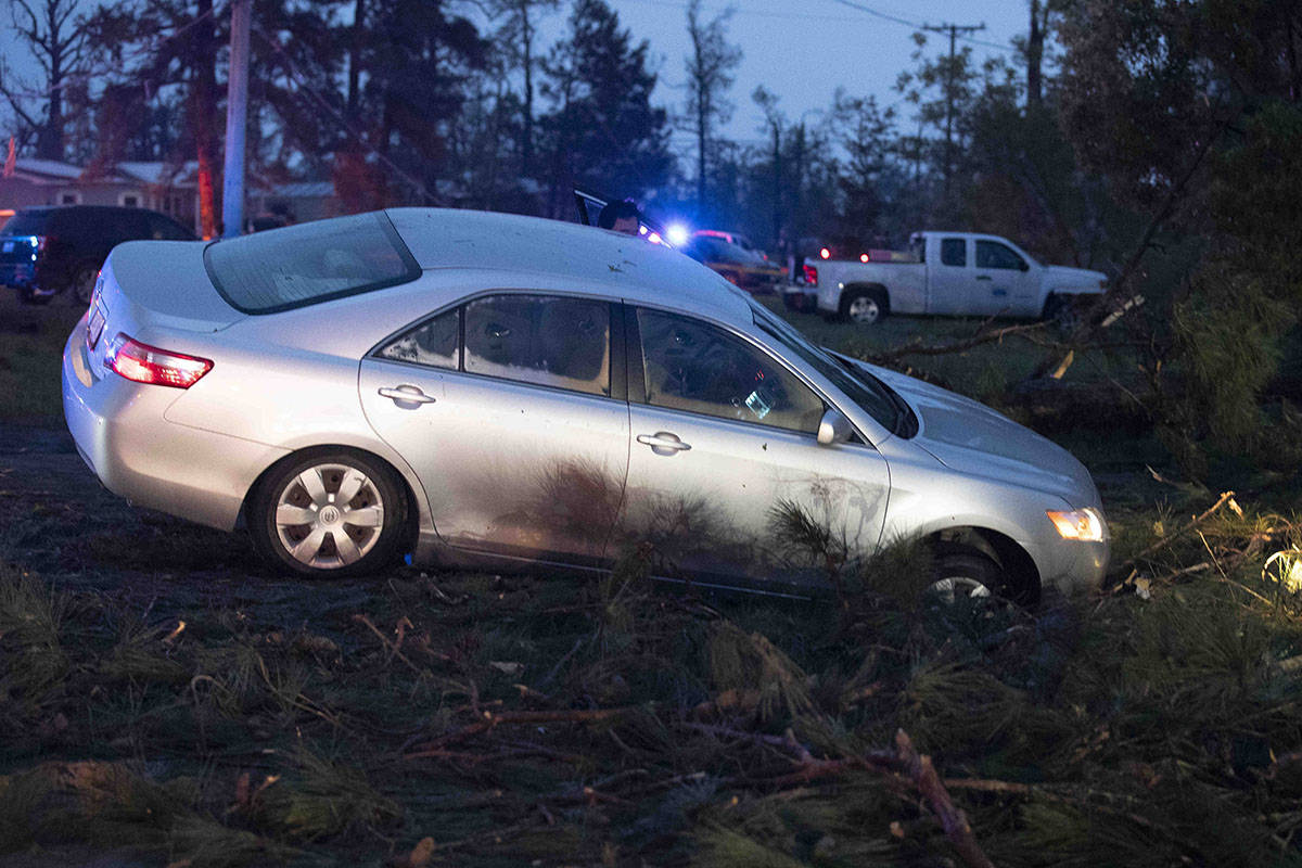 A car is seen in a ditch in Onalaska, Texas, after a tornado touched down in the area Wednesday ...