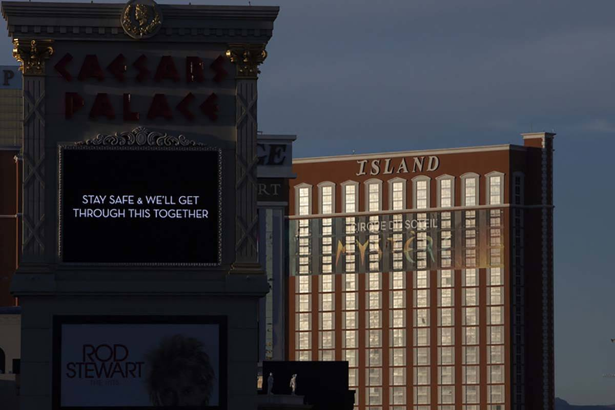 The sun sets on the Strip, including Caesar's Palace and Treasure Island on Tuesday, March 24, ...